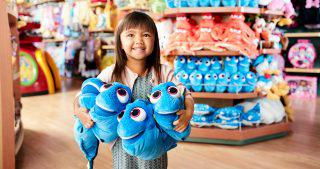 Little Girl in a Disney Store with Dory Plush Toys Small