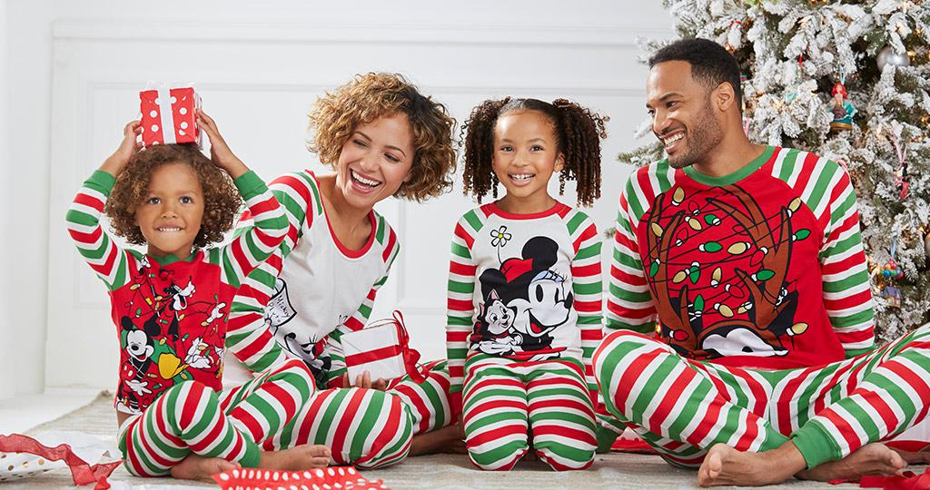 Family dressed in Disney sleepwear on a holiday morning
