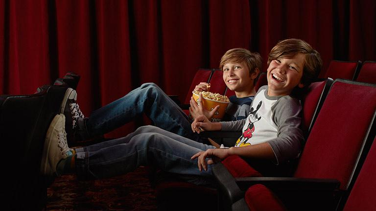 Two Boys Watching Disney Entertainment