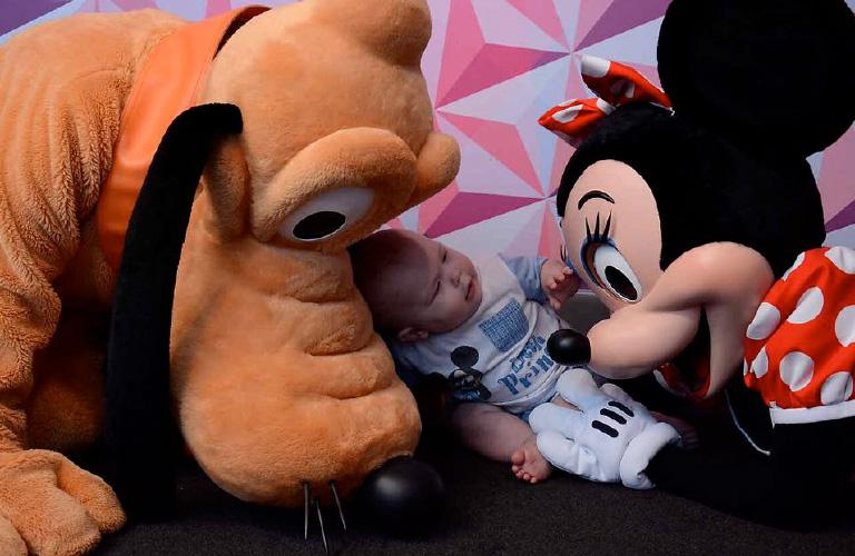 Disney Minnie and Pluto with a baby