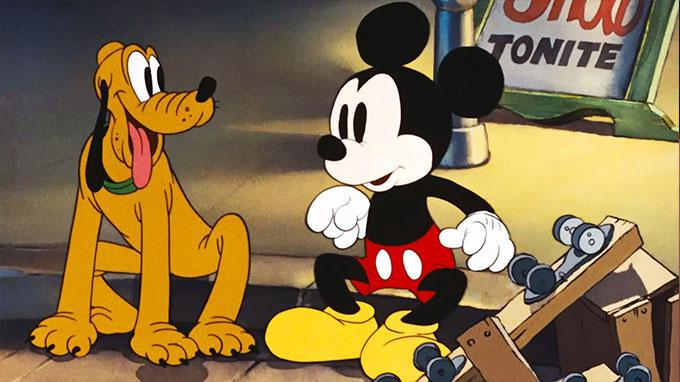 Disney Pluto sitting with Mickey