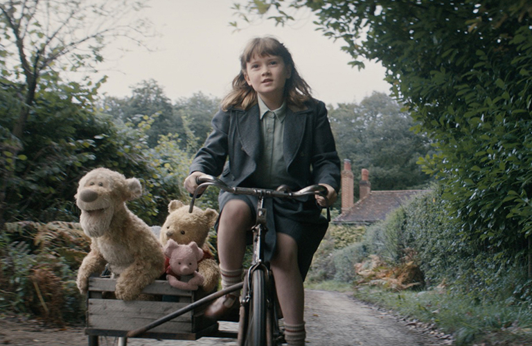 Christopher Robin with bike