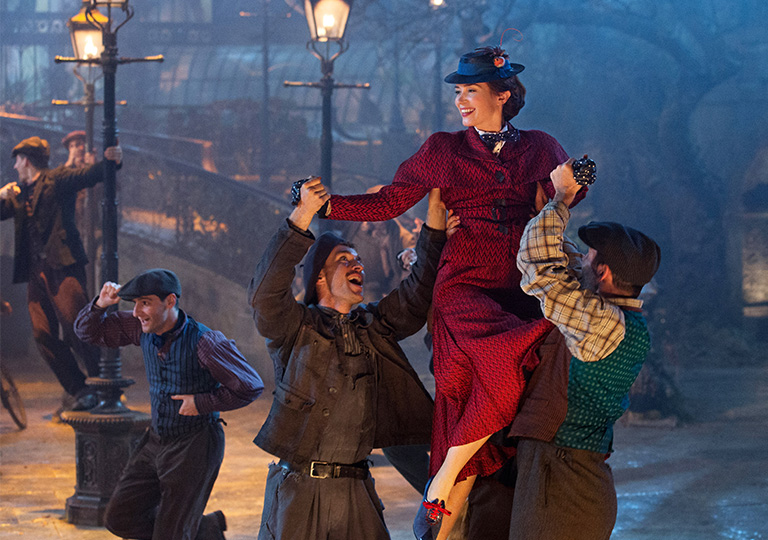 Mary Poppins being lifted up while dancing in the street