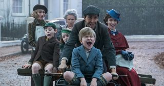 Mary Poppins and Banks family riding down the street