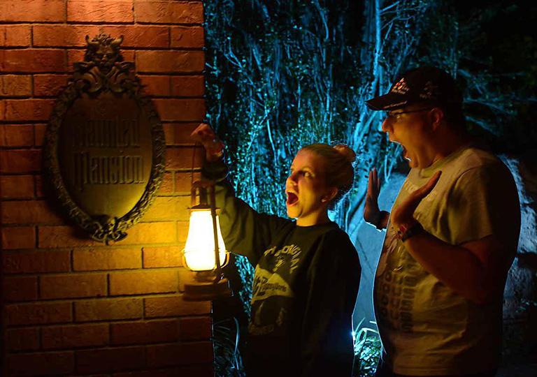 brother and sister at Disney's Haunted Mansion attraction