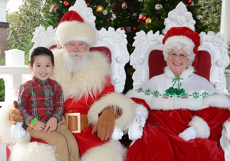 boy with Santa and Mrs Clause at Disney