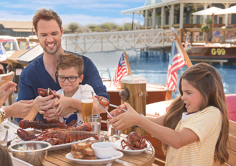 Family eating seafood together at Disney Springs Boathouse