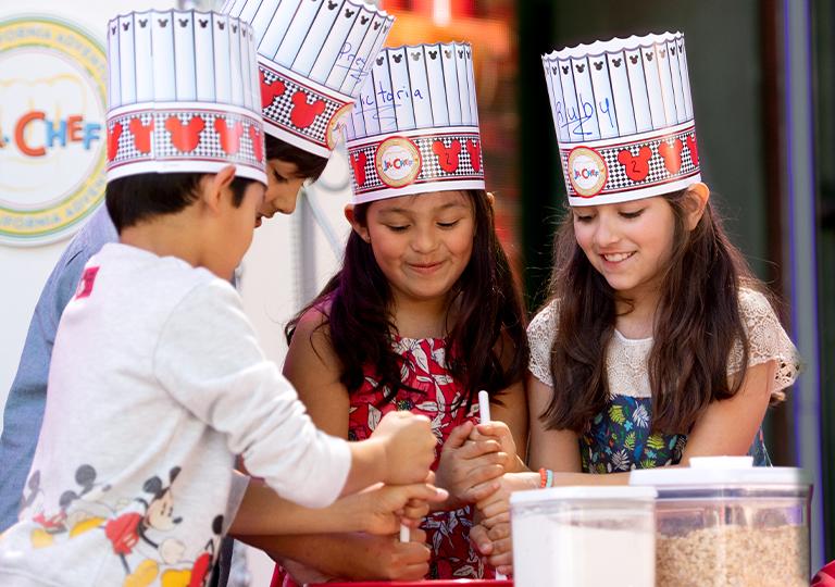Jr. Chef kids at Disneyland baking together
