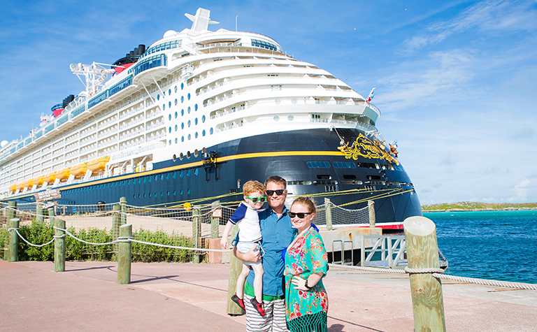 Couple in front of Disney cruise ship