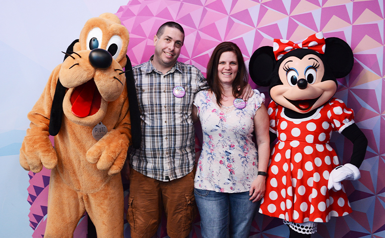 couple with Disney Minnie and Pluto at Epcot