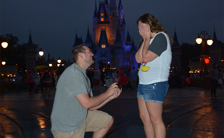 disney marriage proposal in front of castle