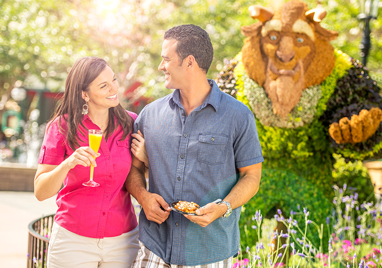 Couple enjoying food and drink at Disney Flower and Garden Festival