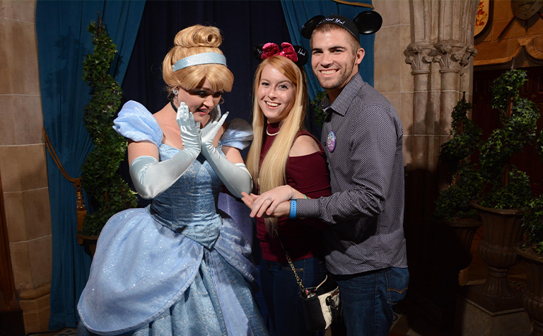 couple taking photo with Cinderella