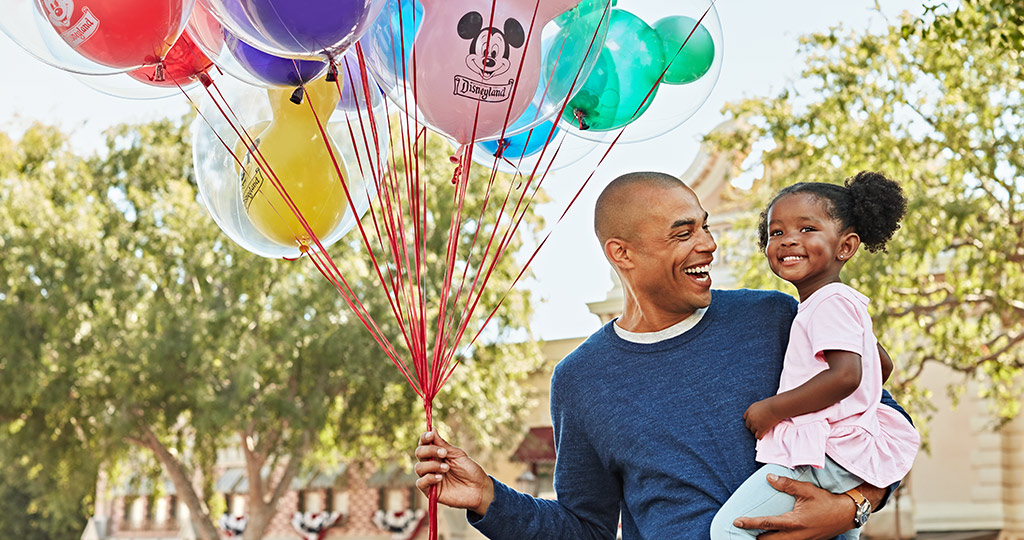 Disney dad and daughter with balloons