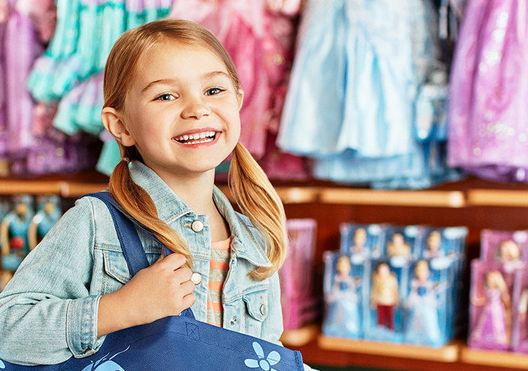 Girl shopping at disney