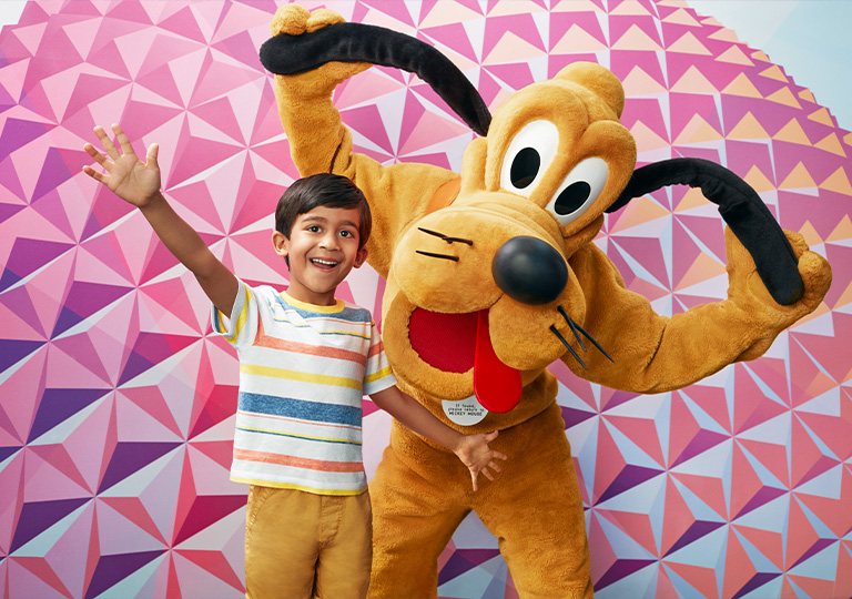 boy posing with Pluto