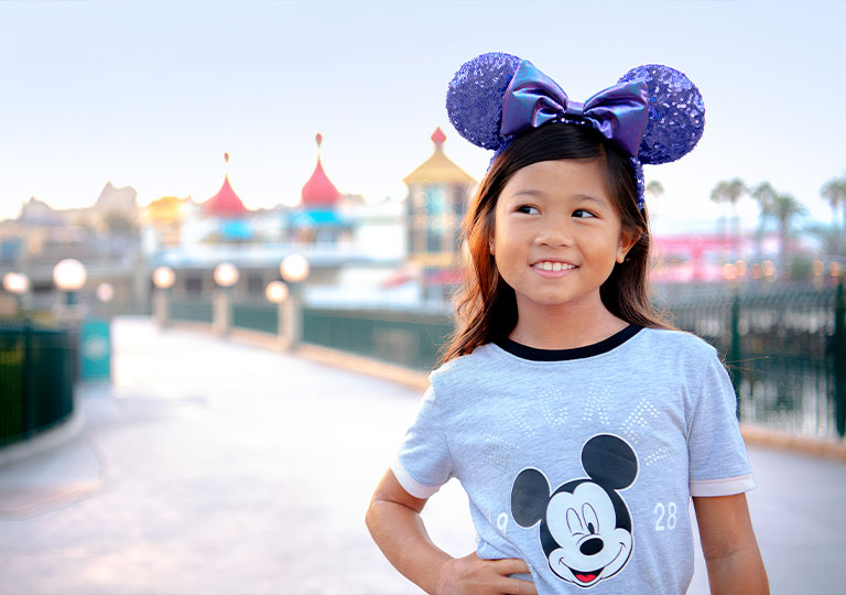 girl posing with Disney gear on