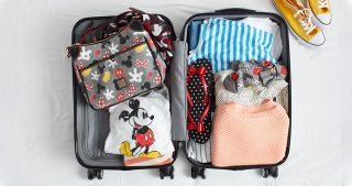 packed suitcase with Disney gear