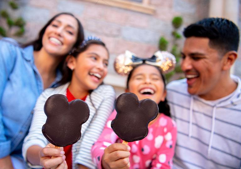 Family snacking on Mickey Ice Cream bars