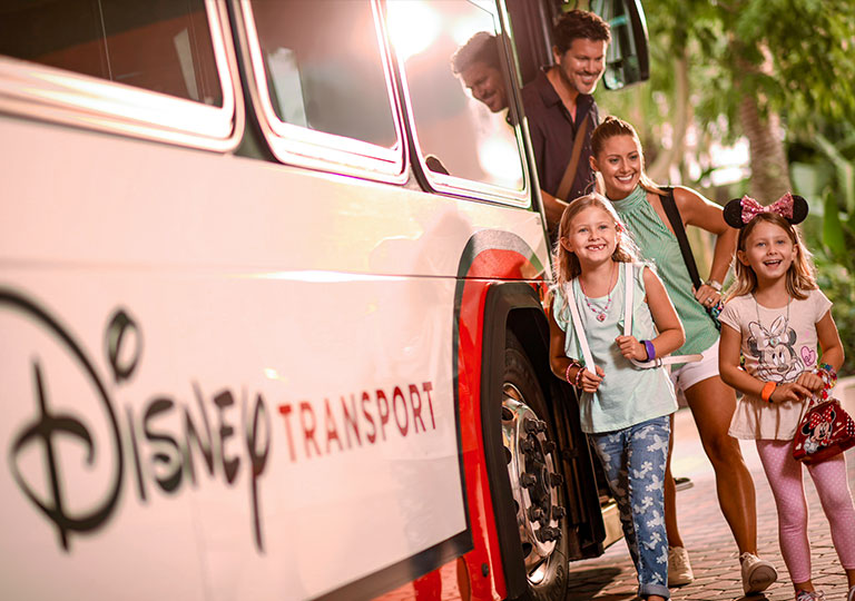 Family getting off of Disney Transportation bus