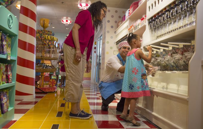 Girl getting candy from store