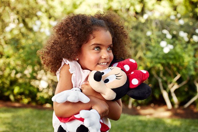 Girl hugging Minnie Mouse