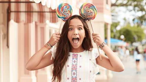 Girl with Mickey Lollipops