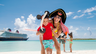 Mom with pirate hat and son with Mickey ears